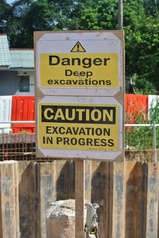 """Safety signage """"Danger - Deep Excavation"""" at the construction site. Safety signage used to make sure workers aware activities ahead and to avoid accident happen. Activities Attention Caution Sign Construction Site Cross RISK Signage Workplace Accident Alert Barricade Danger Dangerous Day Deep Excavation Excavation Fence Maintenance Precaution Progress Project Restriction Safety Trench Warning Sign"""