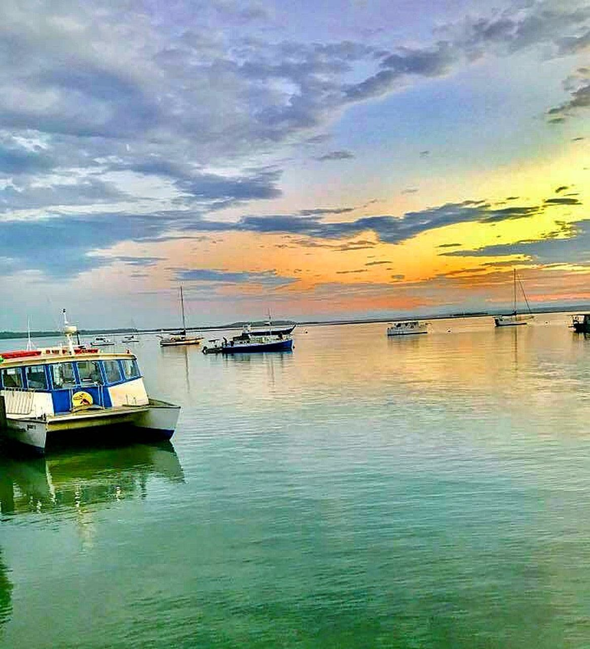 nautical vessel, transportation, water, mode of transport, moored, sky, reflection, cloud - sky, nature, scenics, boat, sea, beauty in nature, tranquility, tranquil scene, no people, sunset, outdoors, waterfront, outrigger, day, horizon over water