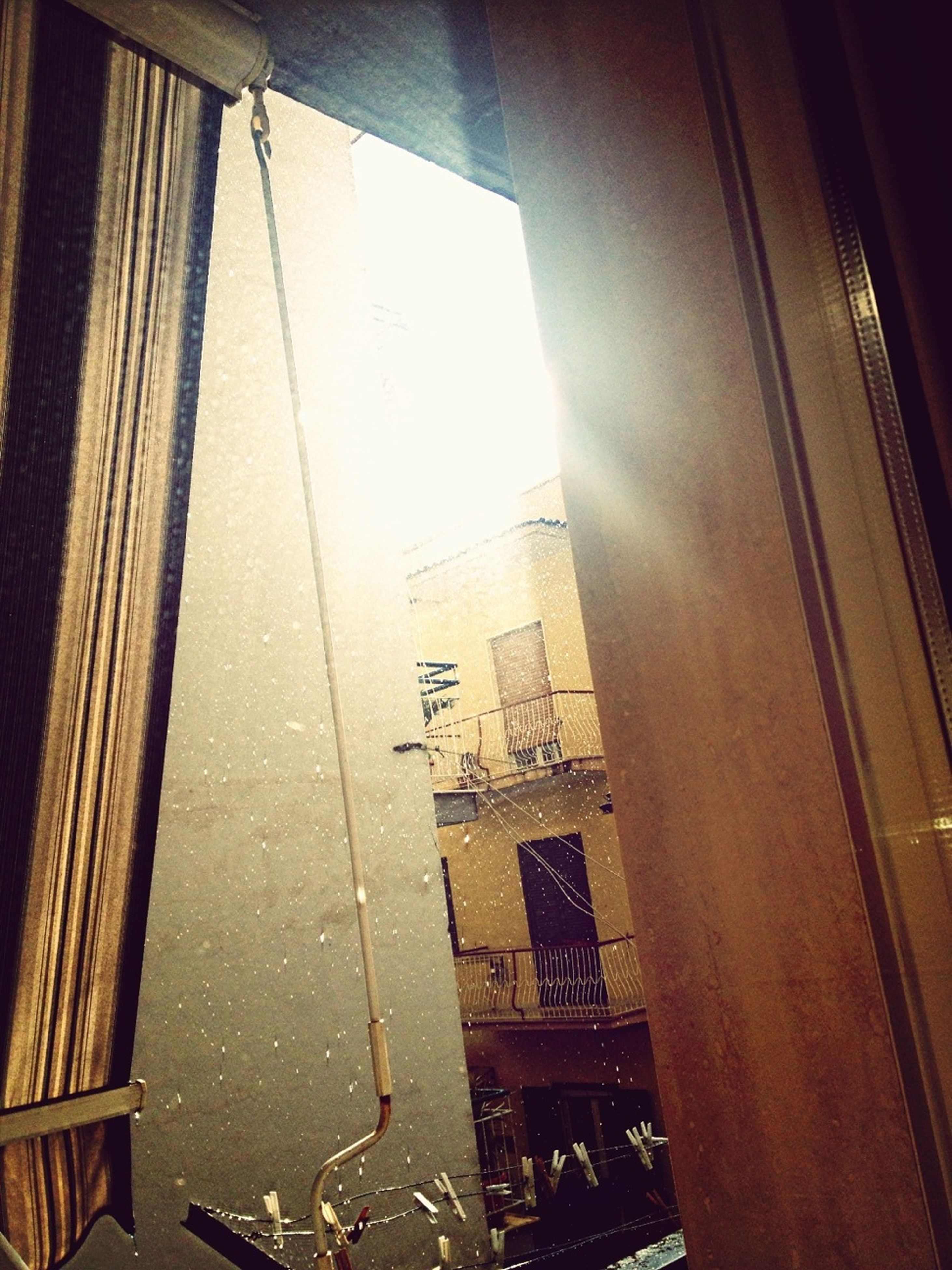 architecture, built structure, indoors, window, door, wall - building feature, building exterior, low angle view, sunlight, house, no people, building, wall, home interior, day, shadow, closed, residential structure, lighting equipment, entrance