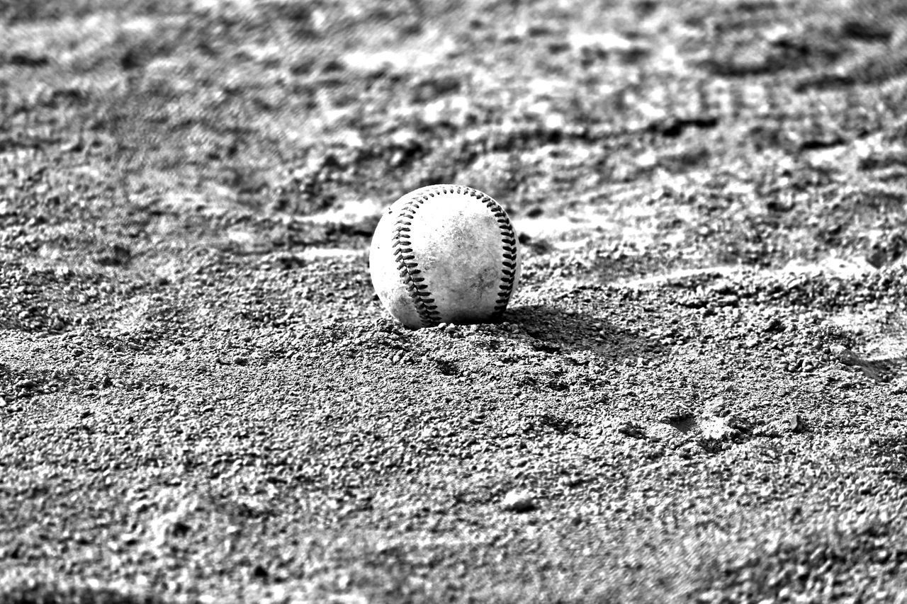 Ball Baseball - Ball Baseball - Sport Baseball Bat Baseball Glove Baseball Pitcher Close-up Day No People Outdoors Sand Selective Focus Sport Team Sport