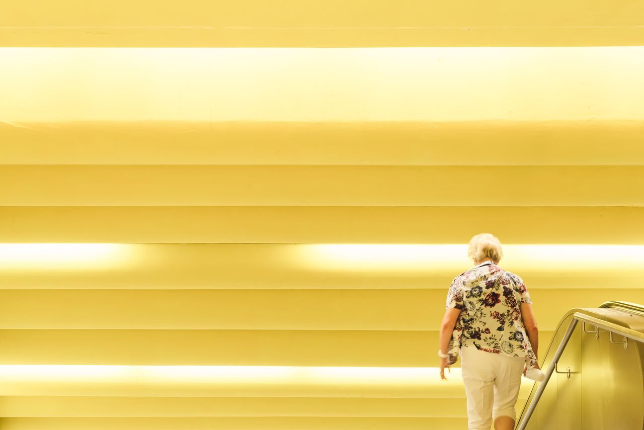 Beautiful stock photos of street photography, rear view, yellow, real people, one person