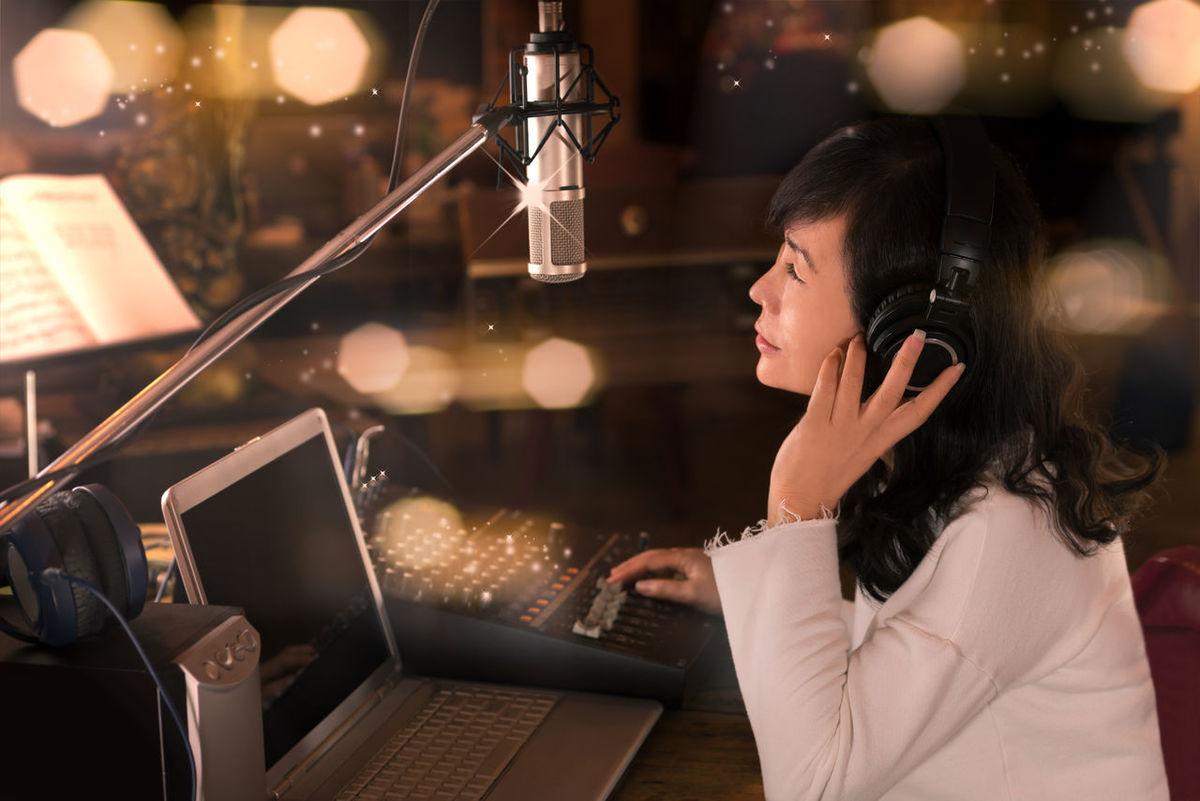 Professional radio broadcaster. Recording Studio Concert Digital Mixer Dj Headphones Laptop Computer Live Recording Man And Woman Microphone Producers Dj Radio Broadcaster Smiling Face Vocalist