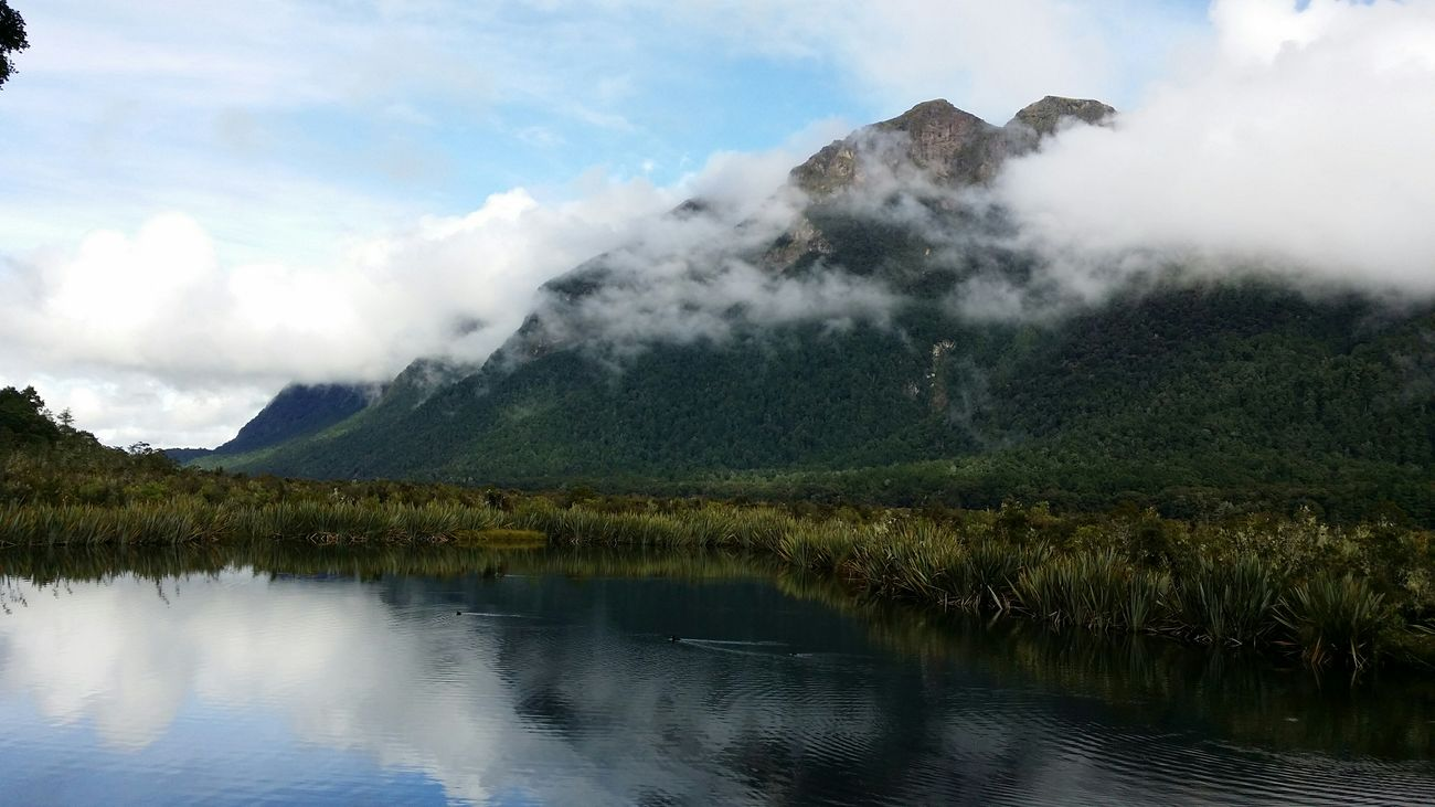 New Zealand Fiordland National Park Mirror Lake Clouds And Mountains