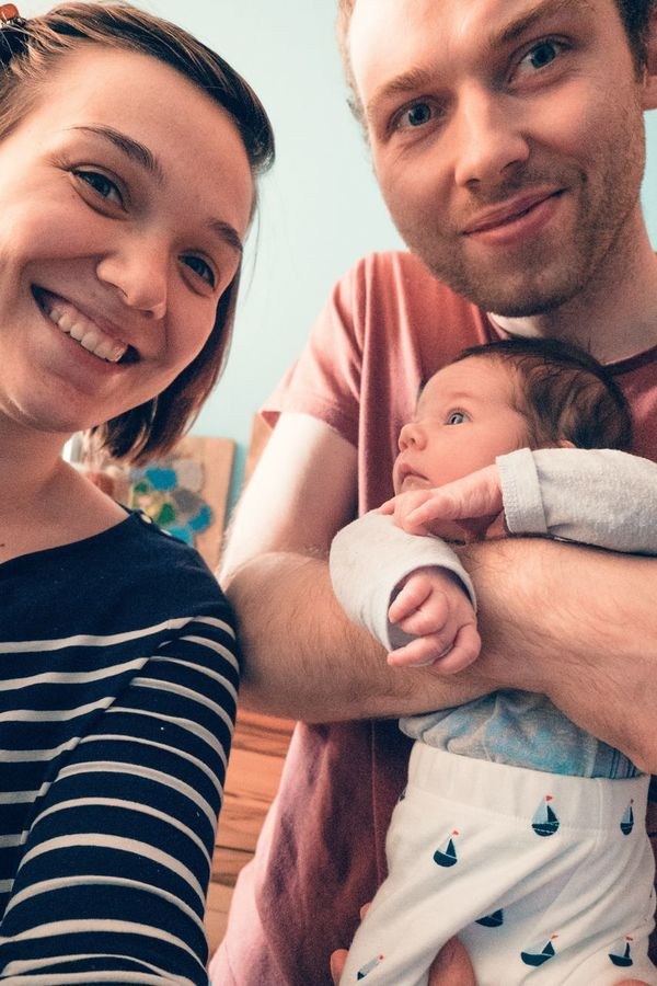 EyeEm Selects Family With One Child Father Mid Adult Men Mid Adult Indoors  Family Men Togetherness Son Care Looking At Camera Childhood Healthcare And Medicine Headshot Happiness Portrait Adult Smiling Real People Close-up Mother Daughter Newborn First Child