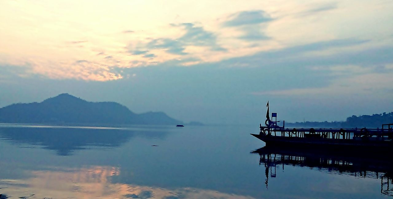 water, sky, nature, reflection, beauty in nature, sunset, scenics, no people, tranquility, tranquil scene, cloud - sky, nautical vessel, waterfront, outdoors, transportation, sea, built structure, architecture, day