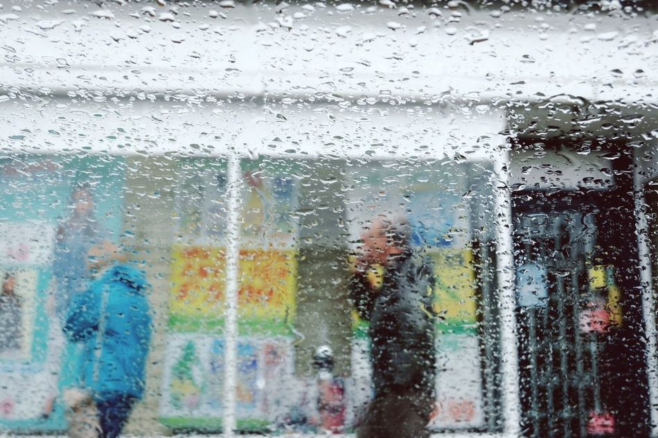 Window shopping | Rain Window Wet Drop Glass - Material Weather Rainy Season Water RainDrop Looking Through Window Day People Backgrounds People Watching Taking Photos EyeEm Gallery Eye4photography  Eyeemphotography