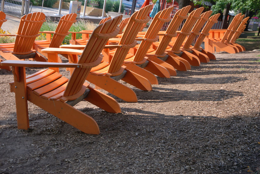 These chairs put me in the summer mood. What will you do this summer? Take a walk on the beach? Sit with your toes in the water? Tell me how you plan to spend your summer.... Beach Chairs City Of Brotherly Love Day Empty Chair EyeEm Best Shots EyeEm Gallery In A Row Leading Lines No People Outdoors Park Parks Parks And Summe Philadelphia Philadelphia Photography Philly Repeating Repeating Patterns Salmon Colored Shadow And Light Summer Summer Fun Summer Views Summertime