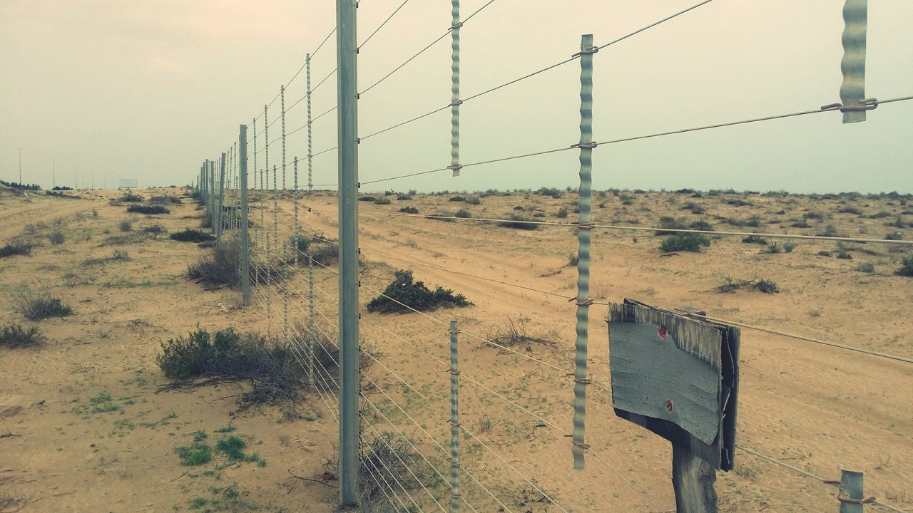 Kiomi Collection Fences Taken By Me Desert Fence Desert Life Fencepost Fence Sand Eye4photography  EyeEm Best Edits Desert Plants Simple Beauty EyeEm Gallery Desert Sandy Dubai UAE