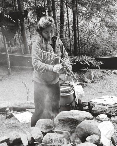 Black And White Natural Simple Crafty Skills  Resourceful Survival Outside Forest Woods Fire Camp Camping One Person Real People Front View Tree Young Women Young Adult Standing Lifestyles Outdoors Full Length Nature People Adult