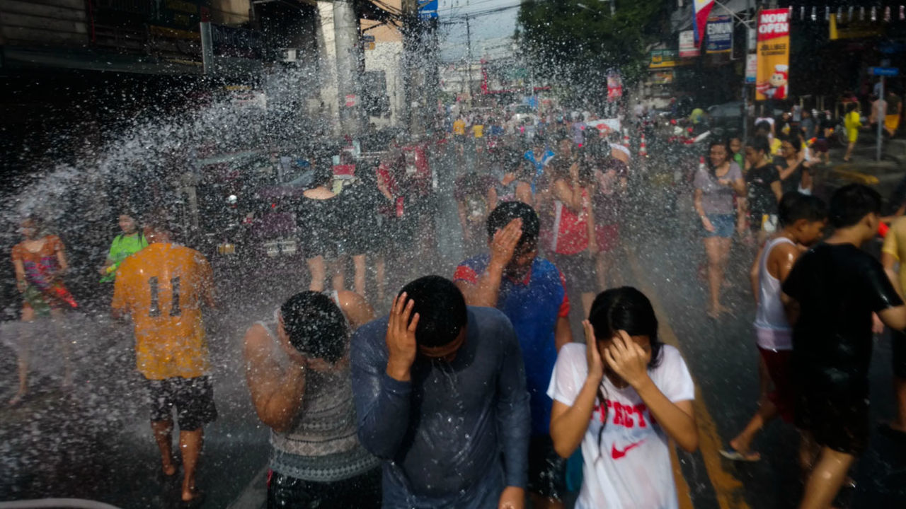 Filipinos dousing each other with water for its annual watta watta festival celebrating the feast of St. John the Baptist. In San Juan City Philippines, June 24, 2016. Celebration Enjoyment Festival Fun Mobile Photography Mobilephotography Motorola Philippines Street Streetphotography Water Golden Moment