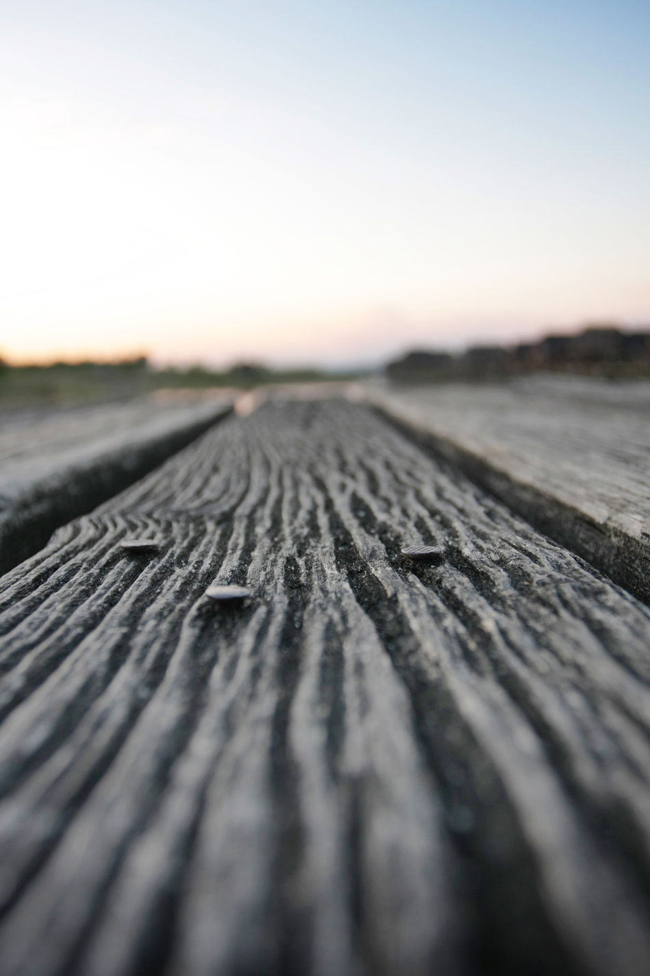 Beauty In Nature Brown Close-up Day Deck Detail Diminishing Perspective Floor Focus On Foreground Landscape Nature No People Outdoors Selective Focus Sky Surface Level Tranquil Scene Tranquility Wood - Material Wooden