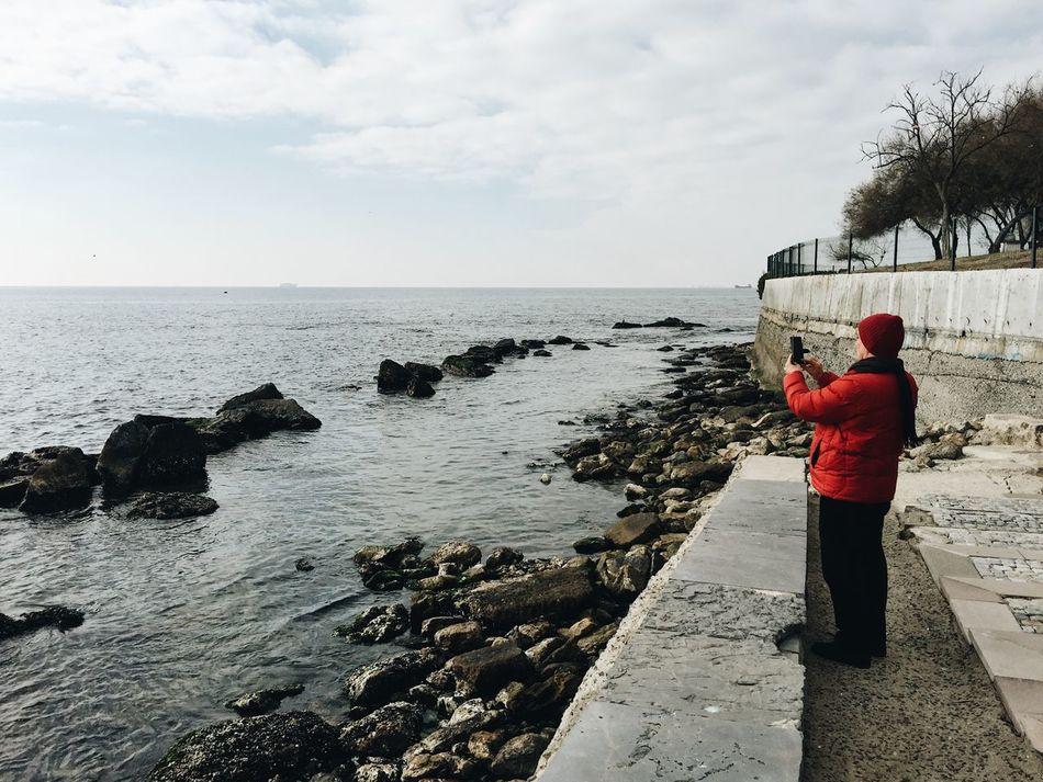 A tourist man takes a photo of Marmara Sea in Istanbul, Turkey Beautiful Beauty In Nature Horizon Over Water Istanbul Marmara Sea Nature Peace And Quiet Sea Taking Photos Tourism Tourist Travel Travel Destinations Traveling Turkey Winter