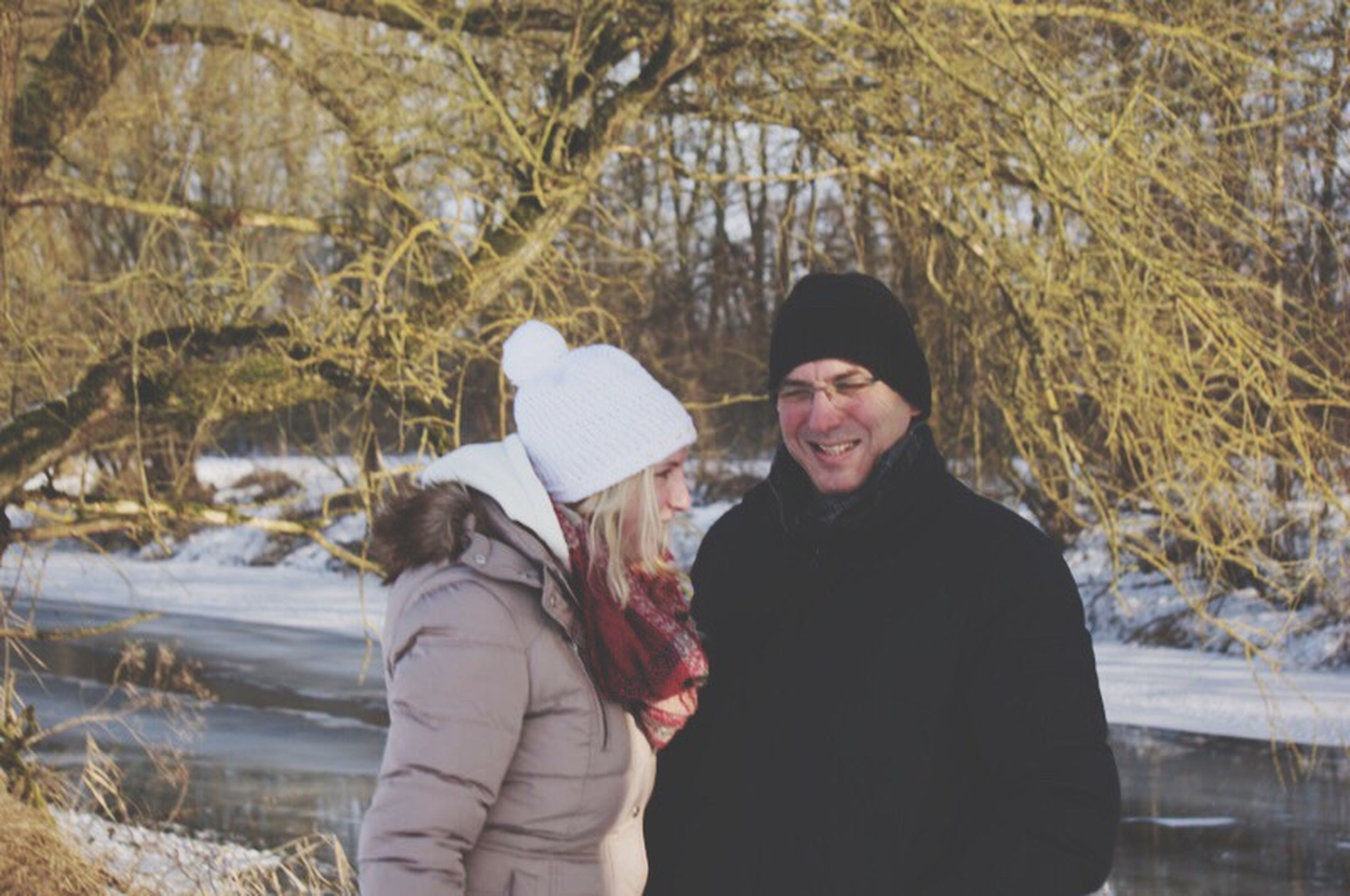 warm clothing, winter, knit hat, cold temperature, tree, snow, mid adult, looking at camera, mid adult men, nature, two people, men, outdoors, portrait, leisure activity, smiling, happiness, day, people, adult, adults only