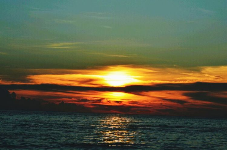 Sunset Sea Beauty In Nature Scenics Nature Dramatic Sky Cloud - Sky Water Horizon Over Water Tranquil Scene Tranquility Idyllic Sky Reflection Sun Outdoors Landscape Sunlight Awe Tropical Climate