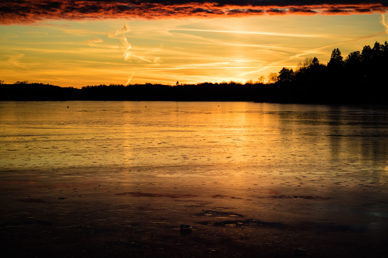 Beauty In Nature Golden Hour Ice Lake Nature No People Orange Color Outdoors Reflection Reflection Scenics Silhouette Sky Sunset Tranquil Scene Tranquility Tree Water Betterlandscapes