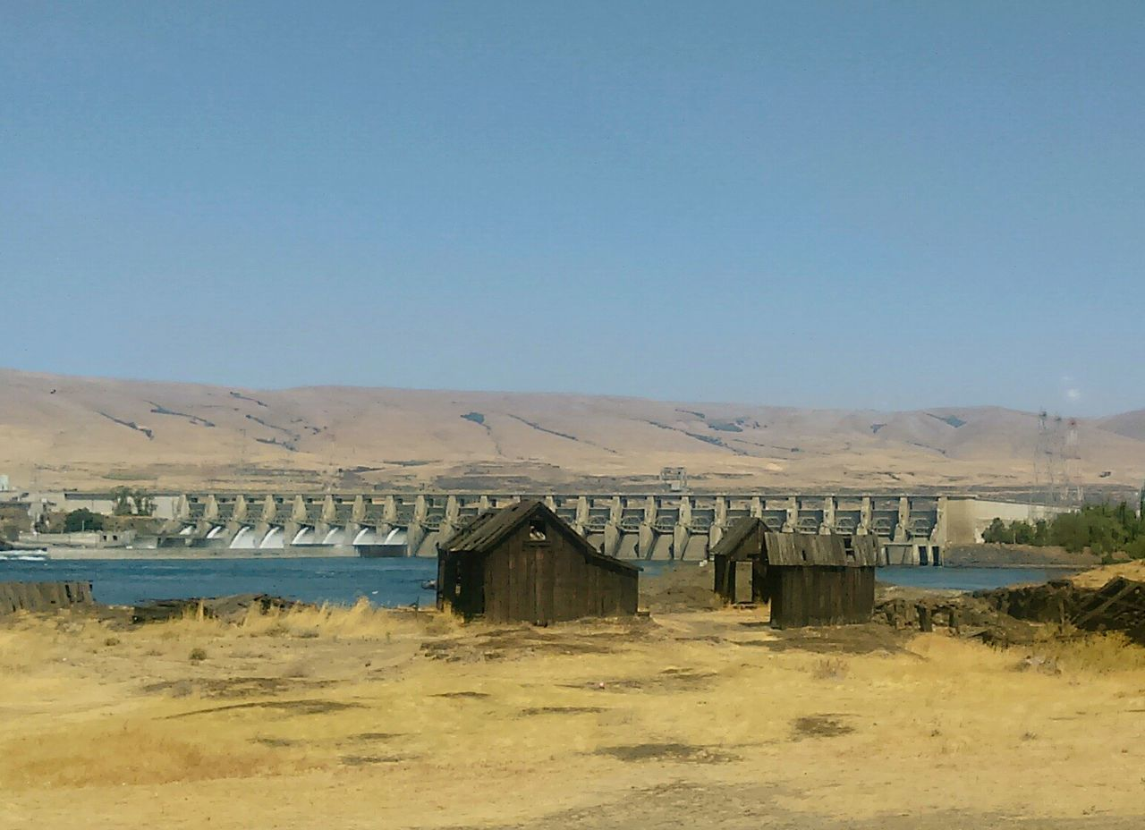 Old buildings in the Dalles with the dam in the background Fast Through A Slow-motion Landscape Color Photography Rural Decay Abandoned Buildings Oregon Hydro Power Photography The Old And The New Water Dam