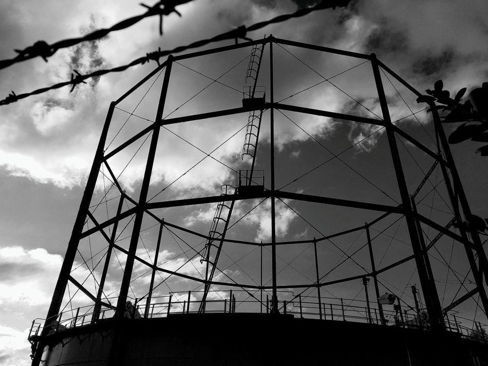 Urban Structure Sky Low Angle View Cloud - Sky Business Finance And Industry Silhouette Built Structure No People Architecture Outdoors Day Black And White White Clouds Metal Gas Storage Industrial Ladder