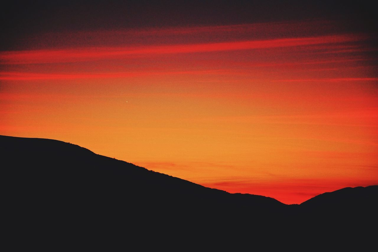 sunset, silhouette, beauty in nature, tranquility, tranquil scene, nature, scenics, mountain, no people, outdoors, sky, landscape
