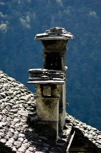 Stoney chimney on old classical stone built house in Ticino Stoney Roof Chimney Chimneys Scenic Pittoresque Ticino Stone Built Classic Ticino Switzerland