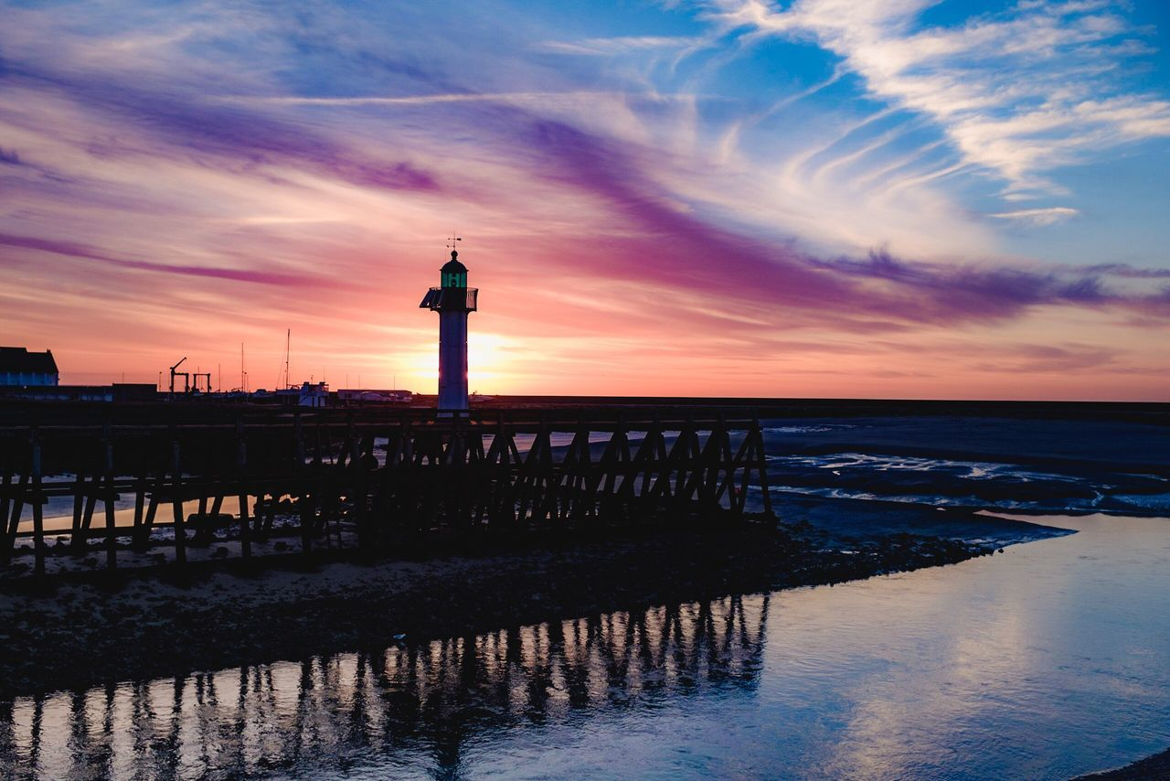 The pier in Trouville France. Trouville Sunset France Sunset Silhouettes Pier Normandie Deauville Light And Shadow French Weather Explore France France Red Sky At Night... Red Sky And The Night Lights Red Sky At Sunset