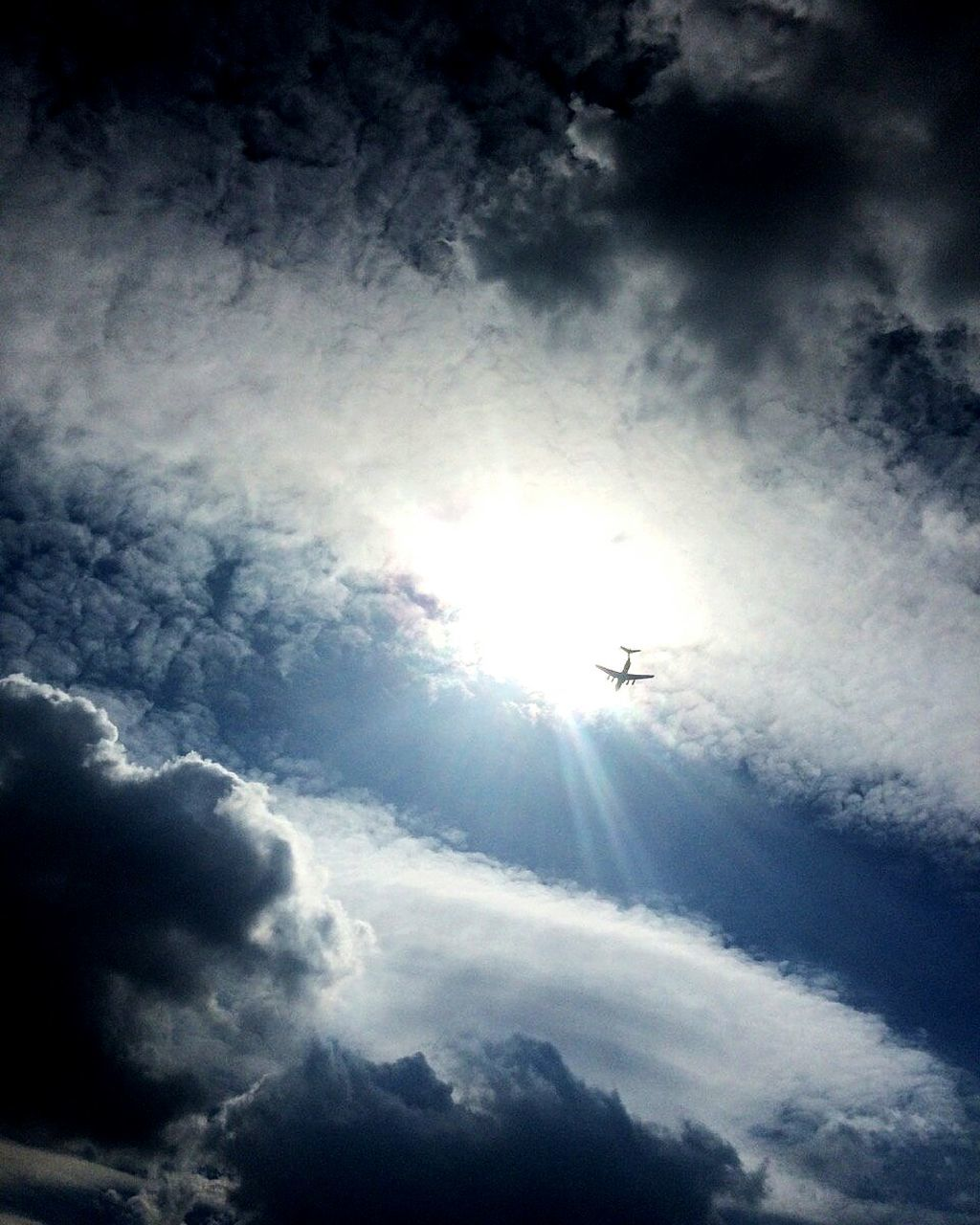 flying, transportation, sky, mode of transport, cloud - sky, low angle view, airplane, journey, silhouette, travel, air vehicle, mid-air, sun, outdoors, nature, day, no people, airplane wing