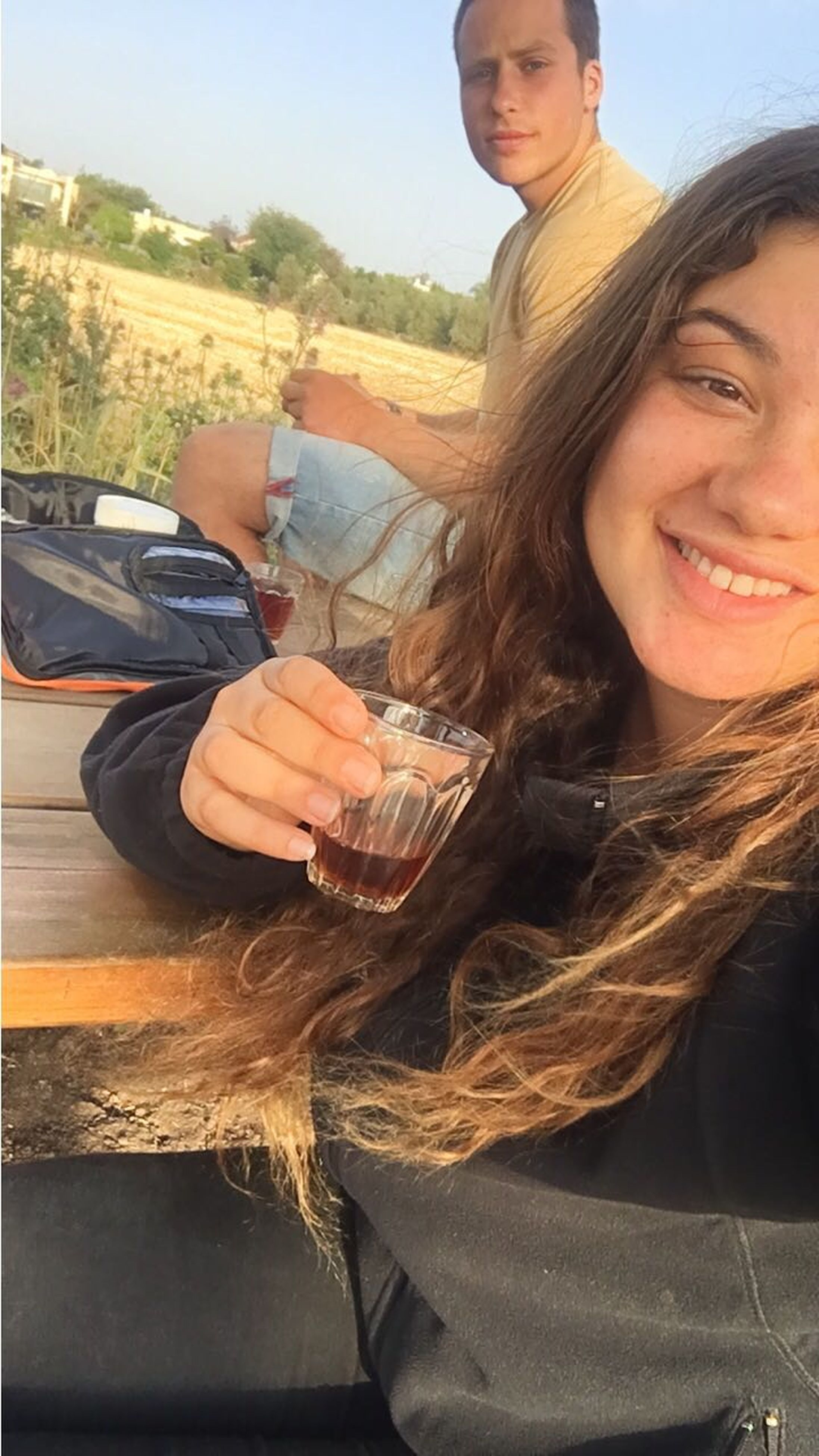 real people, drink, drinking, two people, looking at camera, front view, long hair, smiling, young women, food and drink, leisure activity, day, outdoors, portrait, togetherness, young adult, alcohol, lifestyles, happiness, close-up, cold temperature, friendship, warm clothing, nature, sky, people