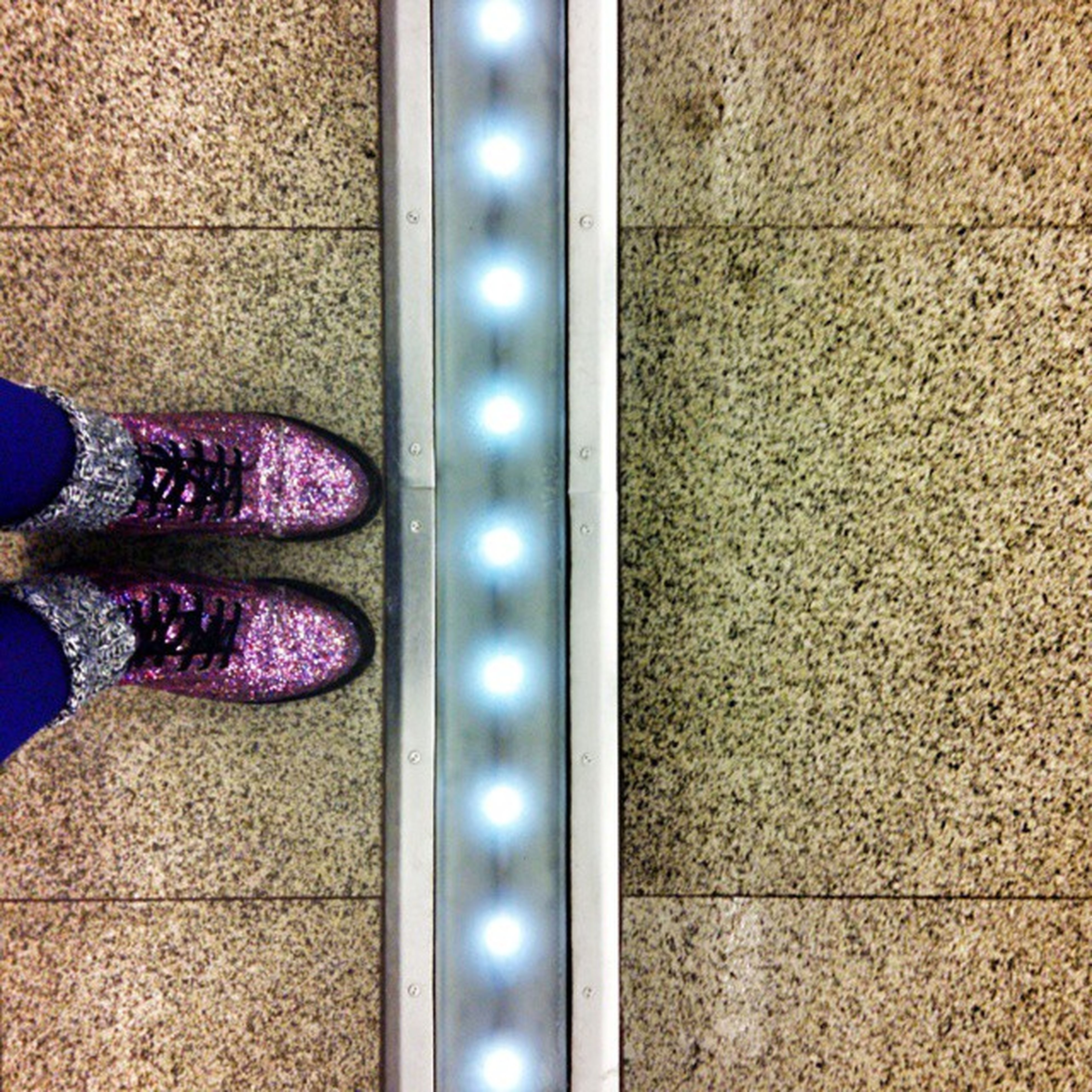low section, person, shoe, standing, human foot, personal perspective, part of, indoors, footwear, lifestyles, unrecognizable person, close-up, leisure activity, pattern, flooring, high angle view, men