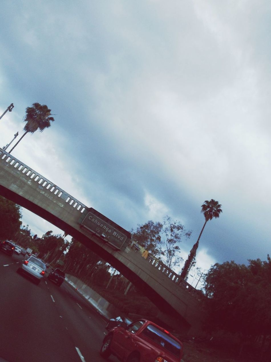 En route. Driving California Summer Cloudy Palm Trees