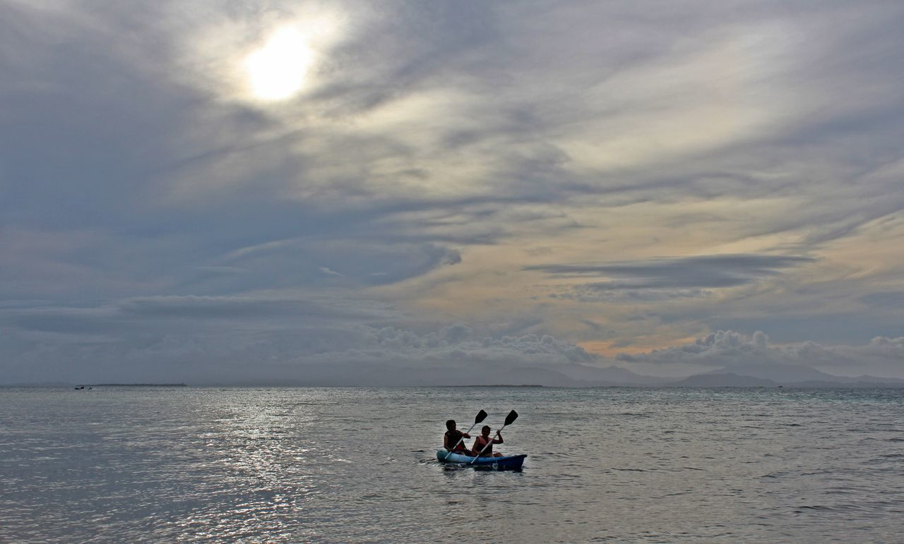 Travel Photography Kayaking In Nature Beach Photography Island Adventure Gray Sky Sunset_captures Dos Palmas Palawan Beach