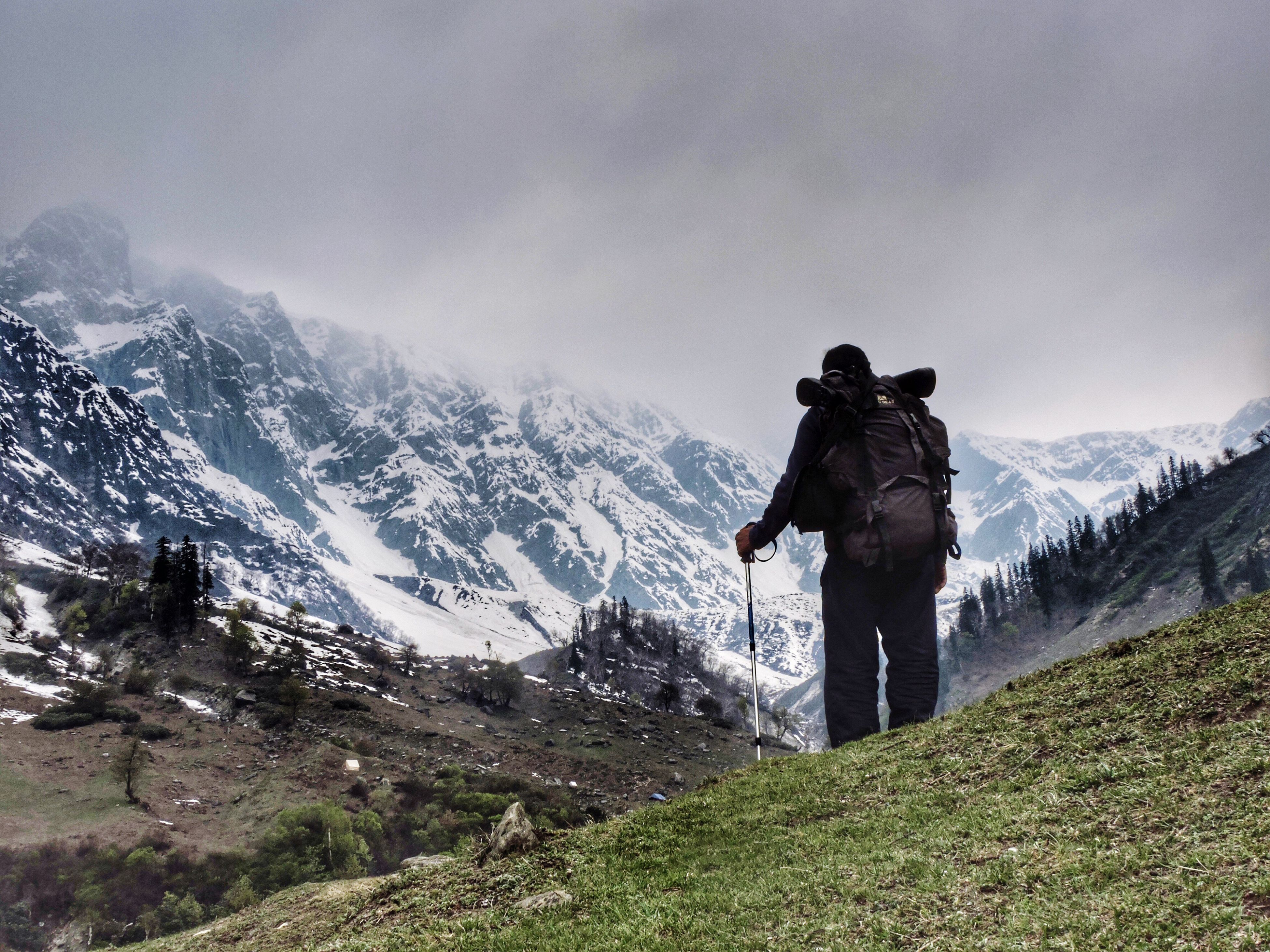 snow, winter, cold temperature, mountain, season, tranquil scene, weather, full length, snowcapped mountain, scenics, mountain range, tranquility, beauty in nature, men, rear view, sky, non-urban scene, nature, adventure, vacations, tourism, mountain peak, outdoors, day