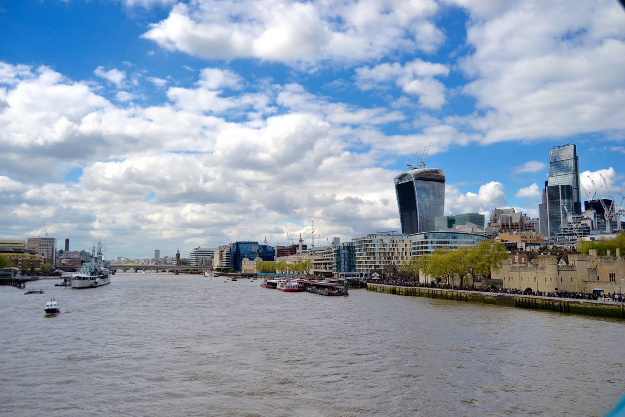 architecture, built structure, building exterior, city, sky, cloud - sky, waterfront, cityscape, river, water, day, no people, travel destinations, outdoors, skyscraper, nautical vessel, urban skyline, nature