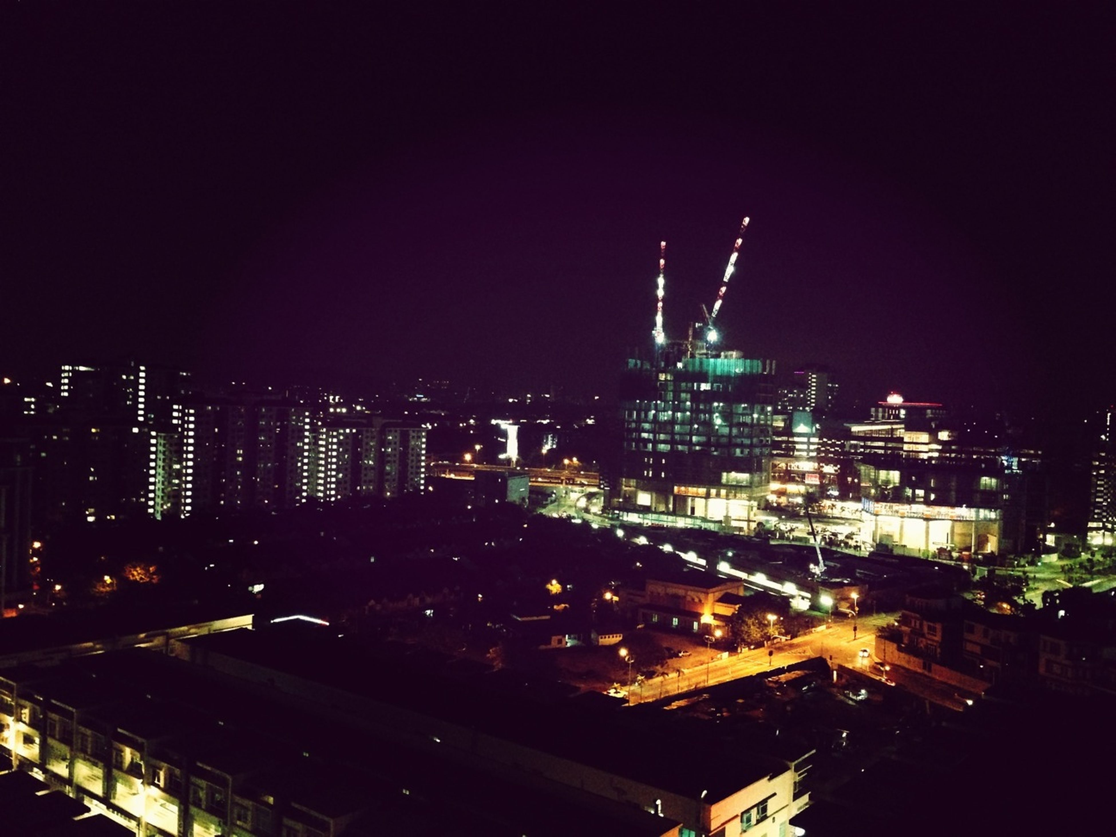 illuminated, night, city, building exterior, architecture, cityscape, built structure, skyscraper, high angle view, tower, tall - high, crowded, city life, modern, office building, copy space, urban skyline, sky, residential district, development