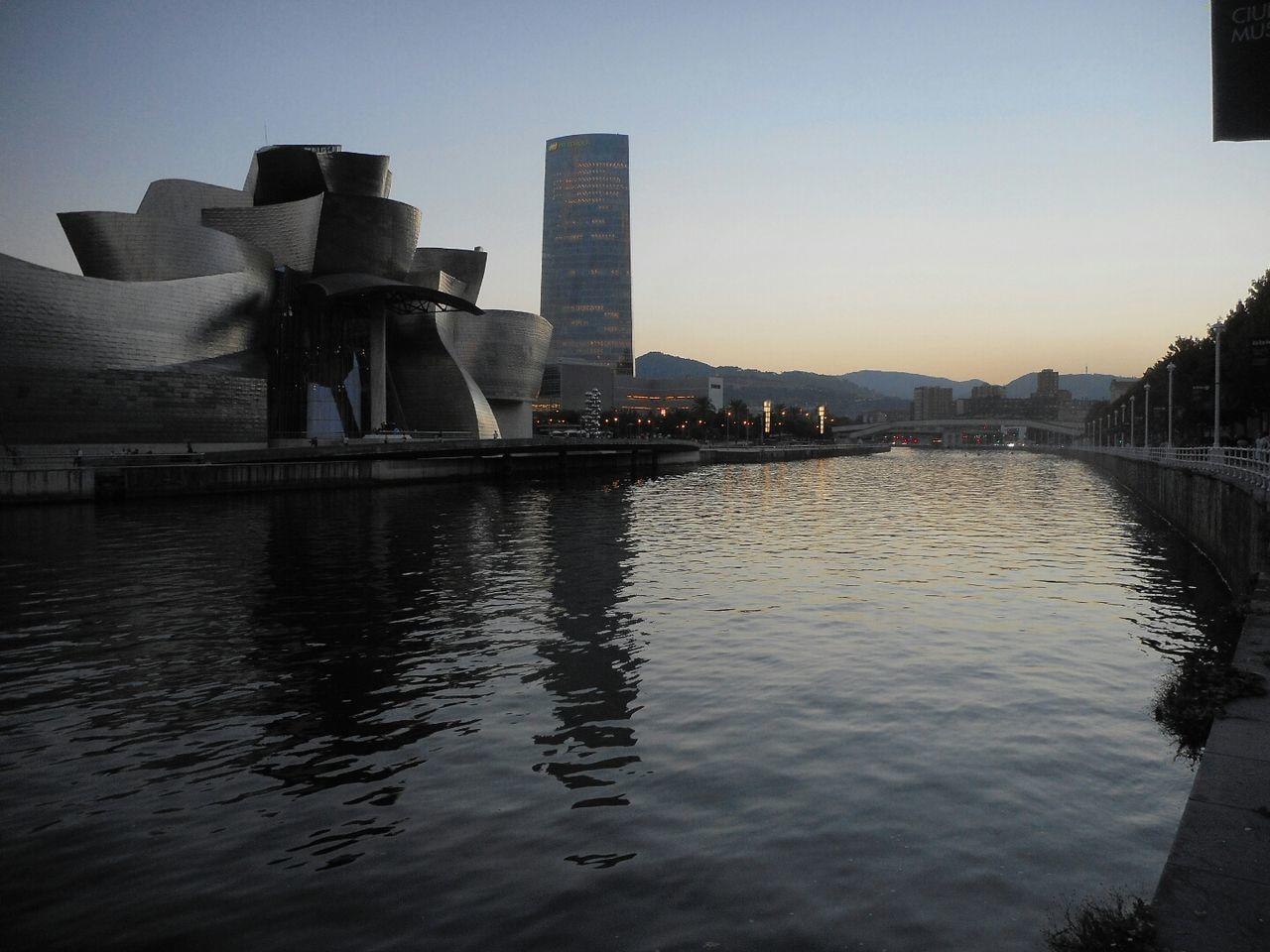 Bilbao at sunset Bilbao Bilbaolovers Building Exterior Water Waterfront Built Structure Urban Scene City Life Architecture Guggenheim Bilbao Sunset