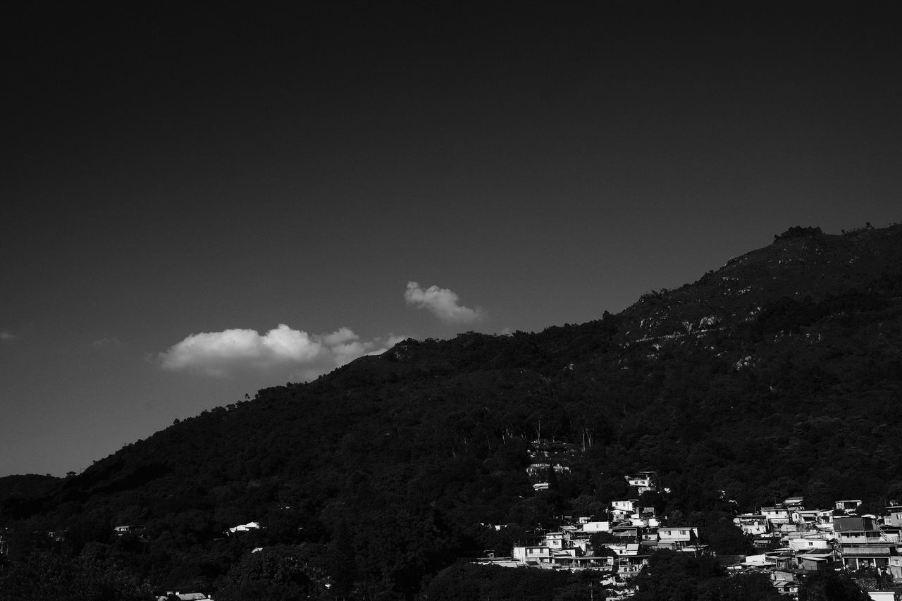Monochrome Photography Mountain Built Structure Building Exterior Architecture Sky Scenics Tranquility Residential District Tranquil Scene Mountain Range Nature Outdoors Day Town Beauty In Nature Fujifilm X-pro2 XF23mmf1.4 Tuenmun Houses In The Nature Non-urban Scene Cloud - Sky Majestic