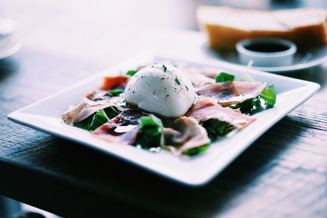 Burrata // Food And Drink Selective Focus Food Freshness Indoors  Ready-to-eat Healthy Eating Surface Level Serving Size Indulgence Meal Plate Appetizer Garnish Temptation Chopped Dish