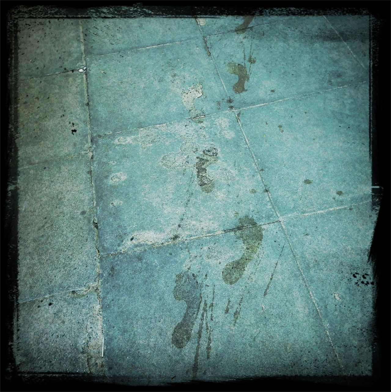 Footprints on tiled floor