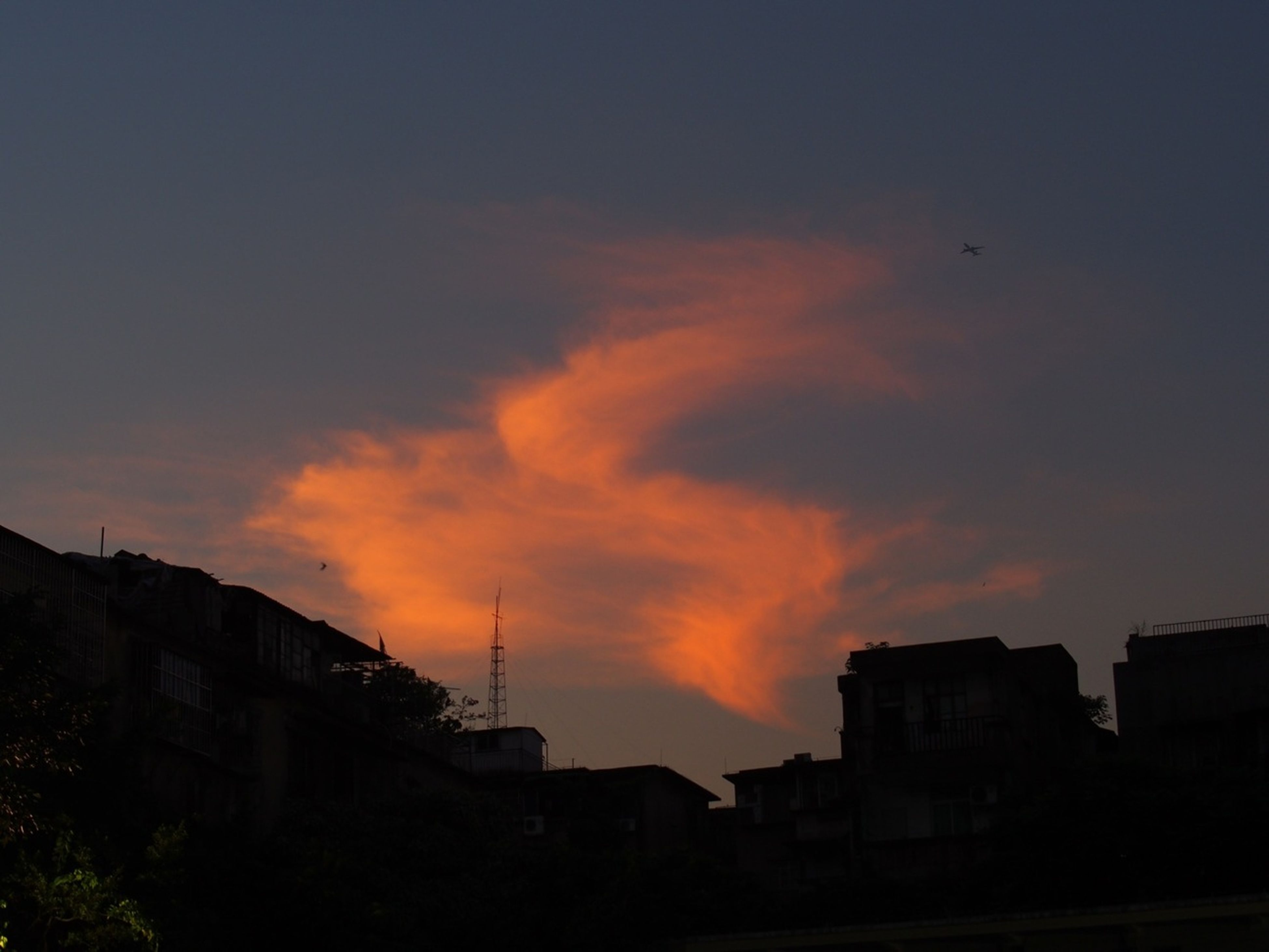 sunset, building exterior, architecture, built structure, silhouette, sky, orange color, cloud - sky, house, residential structure, residential building, low angle view, beauty in nature, building, city, cloud, dramatic sky, outdoors, nature, scenics