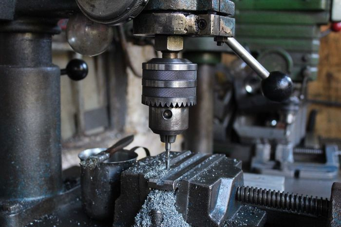 Drill Metal Machinery Focus On Foreground Close-up Sewing Machine Factory Manufacturing Equipment Machine Part Textile Industry Indoors  Textile No People Industry Day Gauge