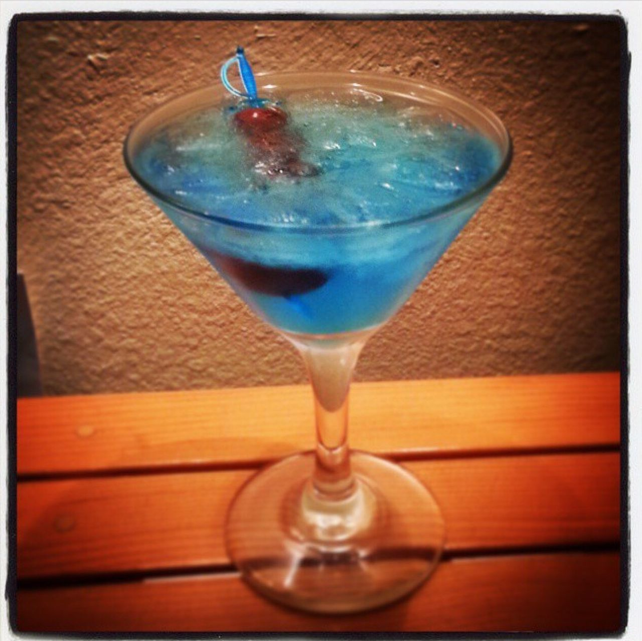 Blue Martini w/ Moonshine Cherries. Hand crafted concoction. Alcohol Cocktails Blue Martini Mixology Colorful Moonshine Cherries Fancy Focused Refreshing Chilled Drink Homemade Drunk In Love
