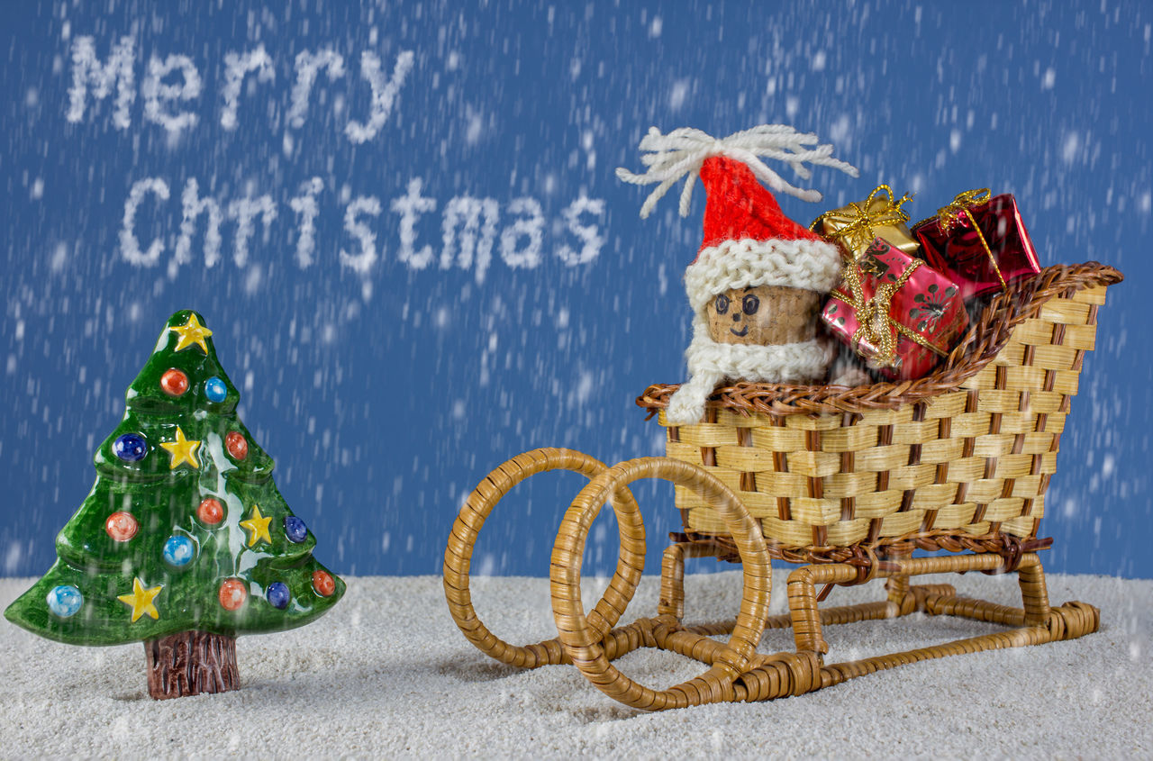 puppets with Christmas-hats and snow falling from the sky Background Cap Card Celebration Christmas Claus December Festive Holiday Merry Red Santa Sky Sleigh Snow Tree White Winter Xmas