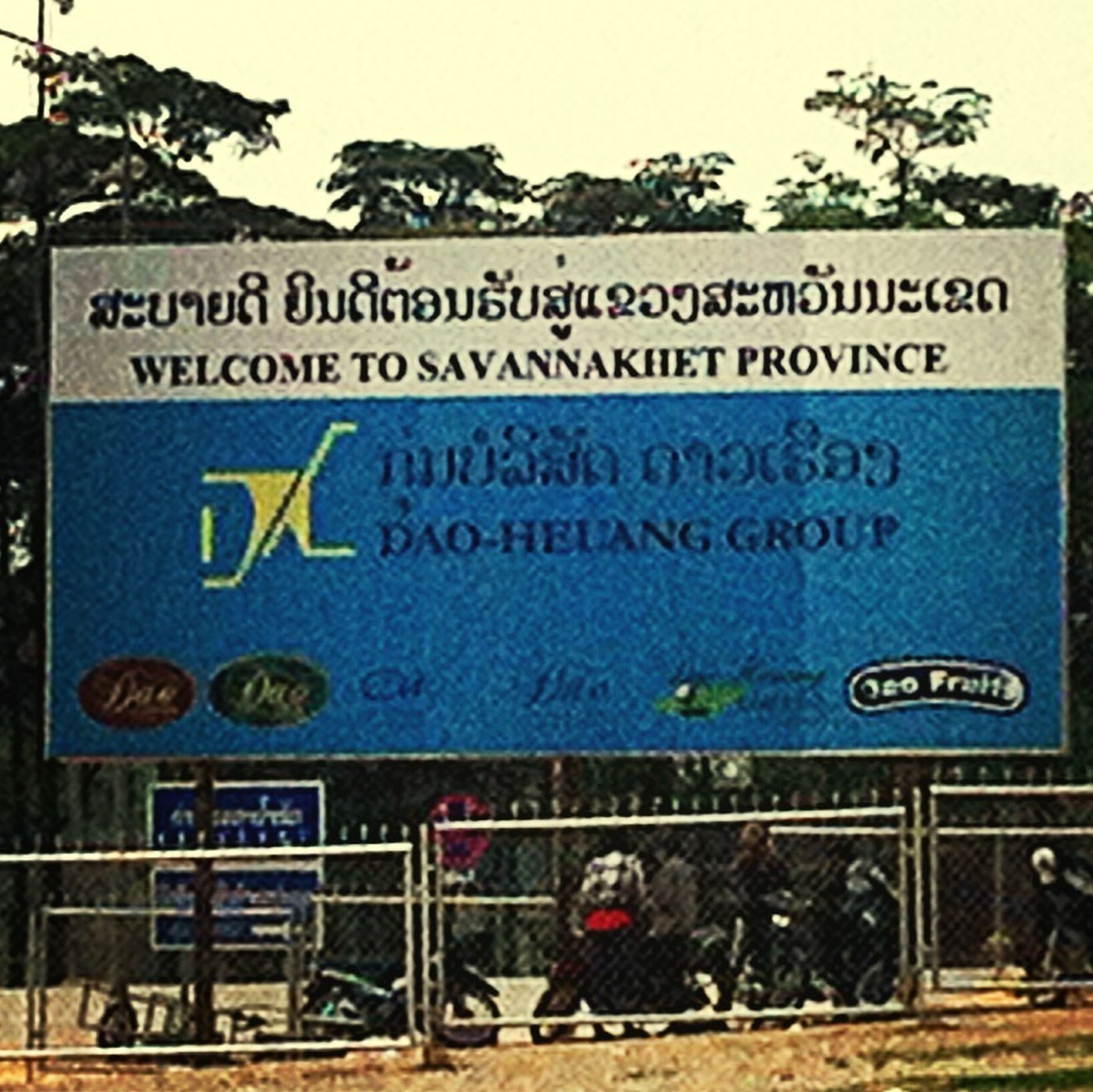 text, western script, communication, information sign, non-western script, information, sign, capital letter, guidance, warning sign, transportation, day, built structure, signboard, outdoors, road sign, architecture, building exterior, directional sign, sign board
