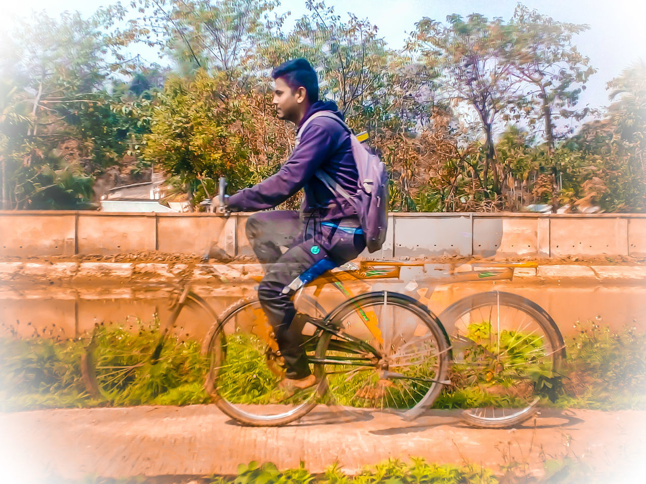 bicycle, full length, transportation, young adult, outdoors, tree, one person, cycling, mode of transport, lifestyles, real people, young men, casual clothing, side view, road, day, nature, young women, people