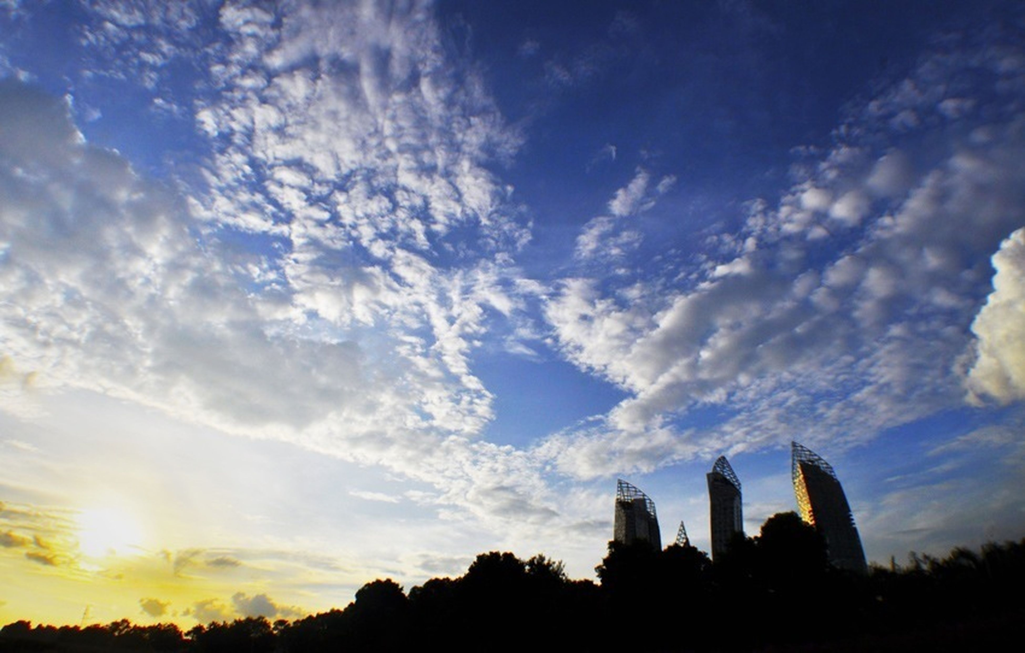 silhouette, architecture, building exterior, built structure, sky, cloud - sky, low angle view, sunset, city, cloud, tree, outdoors, no people, skyscraper, nature, tower, cloudy, dusk, scenics, beauty in nature