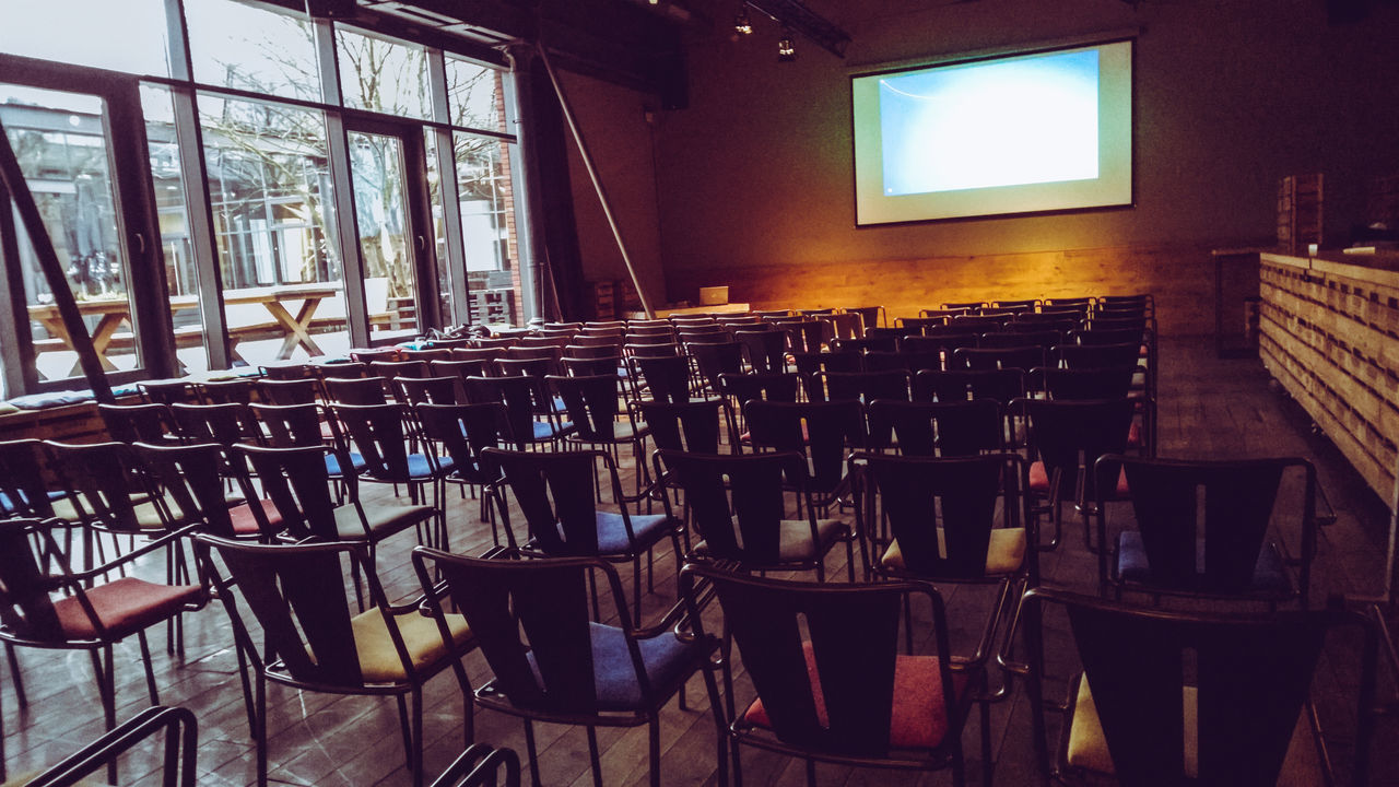 Bar Chair Day Empty Event Event Location Indoors  Large Group Of Objects No People Patio Preparation  Presentation Projector Screen Seat Seating Talk Window