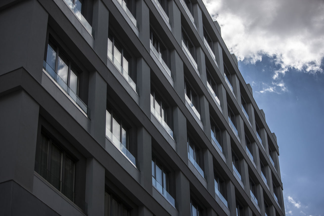 Old building transformed into a luxury hotel - Athens/center - Greece Architecture Athens Building Exterior Built Structure Cloud - Sky Contemporary Day Geometrical Glass Greece Low Angle View Modern Modern Architecture No People Outdoors Sky