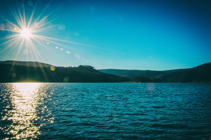 Beauty In Nature Blue Day Direct Sunligt Idyllic Lens Flare Mountain Nature Nikon D3200 No People Outdoors Scenics Sea Sky Sun Sunbeam Sunlight Tranquil Scene Tranquility Water Waterfront