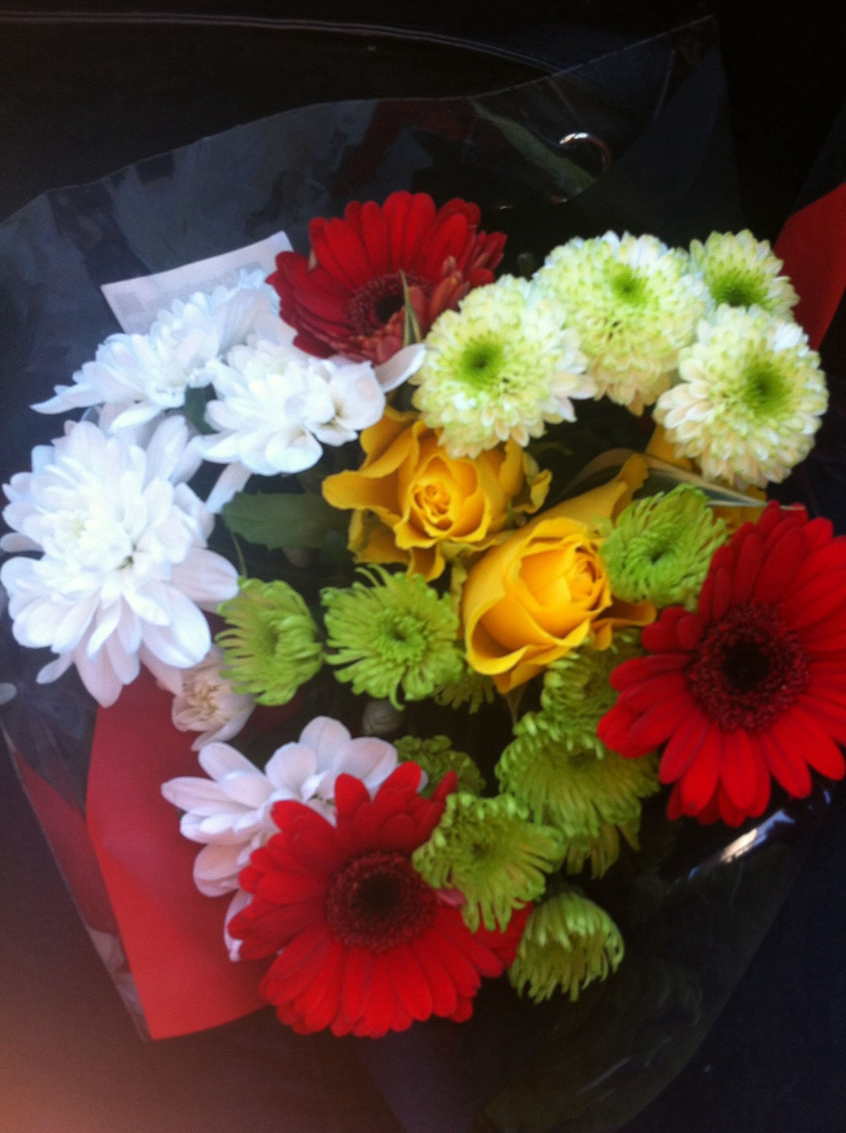 flower, freshness, petal, indoors, fragility, flower head, bouquet, vase, high angle view, beauty in nature, red, bunch of flowers, close-up, flower arrangement, nature, decoration, blooming, table, growth, multi colored