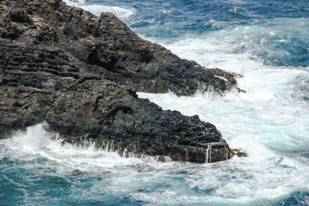 Sea Water Wave EyeEm Best Shots Motion Beauty In Nature Scenics Nature Waterfront Blurred Motion Rippled Alligator Crashing Tranquil Scene Cliff Rocky Outdoors Calm Physical Geography Hawaii Islands Island Vacations Tourism Day