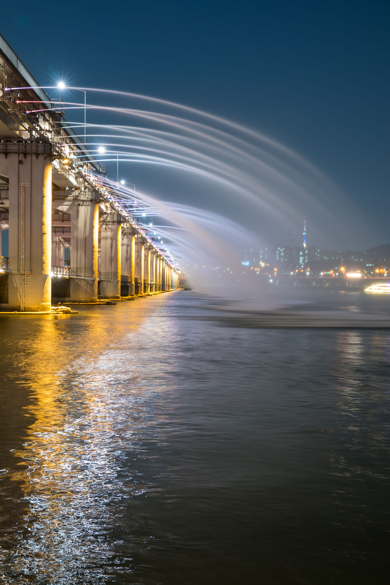 Banpo Bridge with Rainbow Fountain show at Seoul Architecture Banpo Banpo Bridge Banpo Daegyo Bridge Built Structure City Fountain Illuminated No People Outdoors Seoul Sky South Korea Water