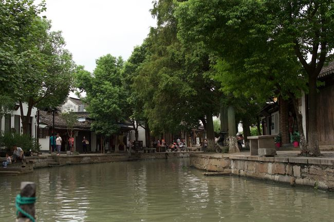 nearly idyllic Built Structure Canal Chinese Culture Day Green Color Group Of People Leisure Activity Lifestyles Medium Group Of People Mixed Age Range Outdoors Rippled Tourism Tourist Tranquility Travel Destinations Tree Vacations Water Waterfront Watertown
